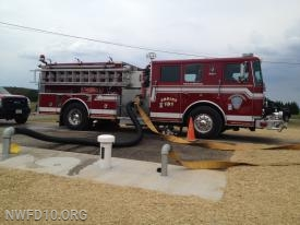 The finished product - E101 set up to draft water from a completed underground water tank. - Uniontown Road